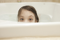 Young Girl In A Bathtub Peering Out