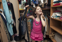 Young Girl In An Adult Woman'S Closet Wearing A Scarf And Ne