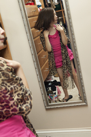 Reflection In A Mirror Of A Young Girl With Leopard Print Sc