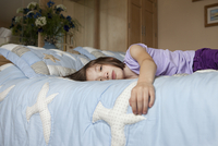 Sad Looking Young Girl Laying On A Bed