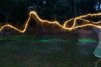 Streaks Of Light From Girl Running With Sparkler