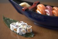 Sushi rolls presented on a leaf