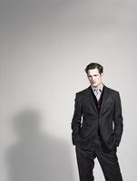 Man posing in his suit