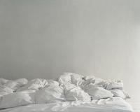 Fluffy white bedding spread
