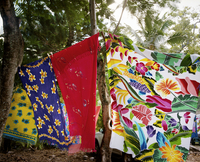 brightly colored fabrics hanging on line