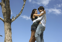 couple hugging near a tree