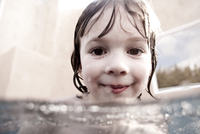 Girl treading water while looking into the camera lens