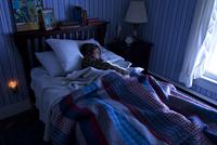 boy sleeping in his bed 20055016542| 写真素材・ストックフォト・画像・イラスト素材|アマナイメージズ