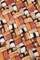 organized pieces of nigiri sushi.
