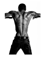 young African American man with tattoos in studio