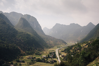 A village lies in the floor of a valley in the Ha Giang province, Vietnam