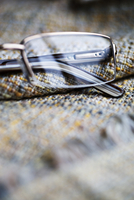 Close-up of spectacles on neutral cloth