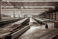 Boxes on conveyor belt at a sorting facility/distribution warehouse.