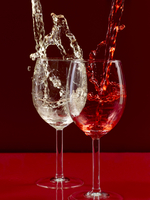 White And Red Wine Splashes Into Glasses