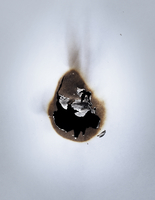Burned hole in paper