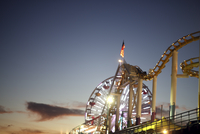 Amusement park at sunset with open sky.