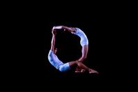 Dancers Form The Letter Q