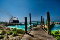 The Disney Magic Cruise Ship Pumps Out Smoke Testing Tis Engines While It Is Docked At Disney'S Private Island.