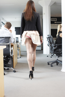 Woman with her skirt tucked into her underwear