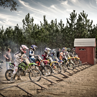 Young motocross racers line up in the starting gate