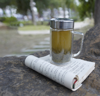 Chinese book and flask of tea on log in park 20055019887  写真素材・ストックフォト・画像・イラスト素材 アマナイメージズ