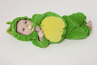 Baby boy wearing a green turtle costume