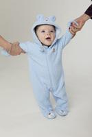 Baby boy wearing a teddy bear onesie