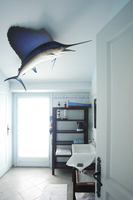 Bathroom view with a lovely Marlin on the ceiling