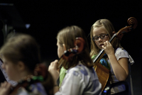 A young cellist concentrates on her concert performance