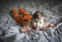 Young baby in Halloween pumpkin costume.