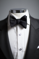 Close up of men's tuxedo jacket and bowtie on mannequin