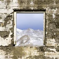 Mountaintop through a stone window