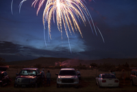 Americana image of a fireworks display on the 4th of July in a small town