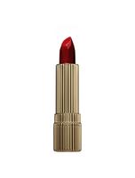Tube of red lipstick on white