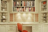 Desk Area In Kitchen With Custom Shelves And Tiled Backsplash