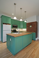 New Kitchen With Butcher Block Island And Green Cabinets