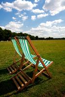 hyde park deckchairs grass sun