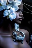 mannequin with blue orchids and gecko lizards