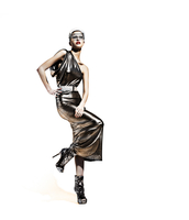 A futuristic model wearing a silver dress and head piece