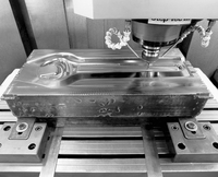 Equipment department: working a die for forging wrenches type 52 on a high-speed, numerically controlled milling machine.