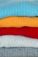 five colorful wool sweaters stacked 20055022783| 写真素材・ストックフォト・画像・イラスト素材|アマナイメージズ