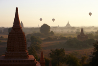 Sunrise and hot air balloons over Buddhist temples - Bagan