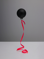 Still life of a black Christmas ball floating on a fluorescent red ribbon in front of a grey neutral backdrop. 20055023079  写真素材・ストックフォト・画像・イラスト素材 アマナイメージズ