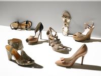 Still life of multiple female summer sandals.