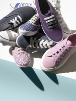 Still life of multiple female fabric summer sneakers.