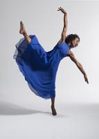 Black female dancer in blue dress against white background 20055023202| 写真素材・ストックフォト・画像・イラスト素材|アマナイメージズ