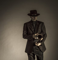 White male trumpet player in costume dramatic lighting