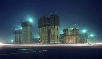 Night view of high-rise towers under construction