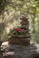 Stones piled in prayer offering on path to temple in Bhutan