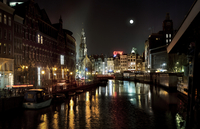 MOON ON WATER AT NIGHT IN AMSTERDAM WITH CANALS AND BARS IN RED LIGHT DISTRICT